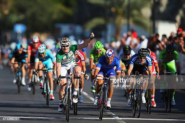 Andre Greipel of Germany and LottoBelisol celebrates winning stage six of the 2014 Tour of Oman a 146km stage from As Sifah to the Matrah Corniche on...