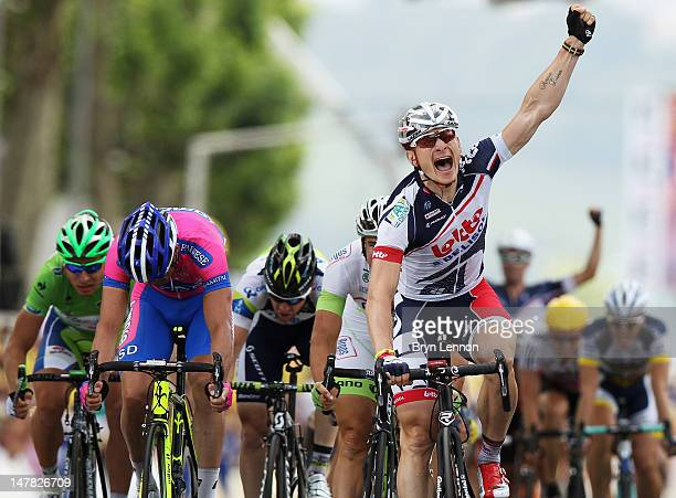 Andre Greipel of Germany and Lotto-Belisol Team celebrates winning stage four of the 2012 Tour de France from Abbeville to Rouen on July 4, 2012 in...
