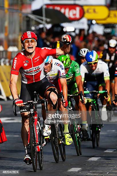 Andre Greipel of Germany and LottoSoudal celebrates as he crosses the finish line to win the twenty first stage of the 2015 Tour de France a 1095 km...