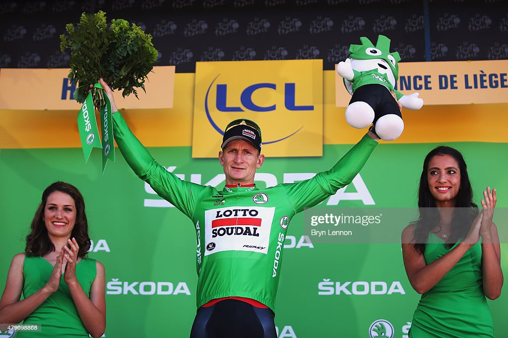 Andre Greipel of Germany and Lotto-Soudal celebrates as he is awarded the green jersey on the podium after stage three of the 2015 Tour de France, a 159.5 km stage between Anvers and Huy, on July 6, 2015 in Huy, Belgium.