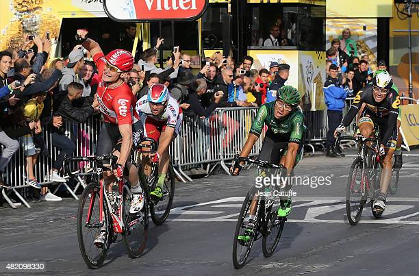 Andre Greipel of Germany and LottoSoudal celebrates winning in front of Bryan Coquard of France and Team Europcar Alexander Kristoff of Norway and...