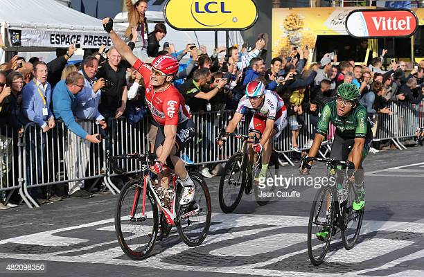 Andre Greipel of Germany and LottoSoudal celebrates winning in front of Bryan Coquard of France and Team Europcar and Alexander Kristoff of Norway...