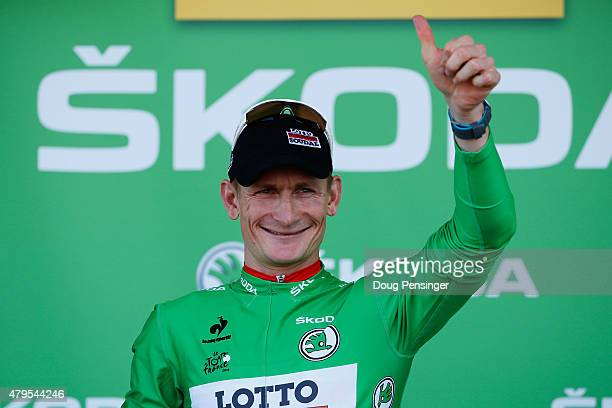 Andre Greipel of Germany and LottoSoudal is awarded the green jersey on the podium after stage two of the 2015 Tour de France a 166km stage between...