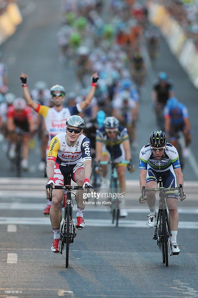 Andre Greipel (L) of Germany and team Lotto Belisol crosses the finish line to win the People's Choice Classic race of the Tour Down Under on January 20, 2013 in Adelaide, Australia.