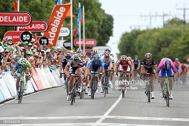 Andre Greipel of Germany and team Lotto-Belisol finishes the race first in a photo finish with Alessandro Petacchi of Italy and team Lampre-ISD...