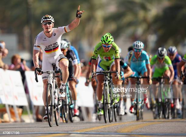 Andre Greipel of Germany and the LottoBelisol team celebrates winning stage three of the Tour of Oman a 145km stage from Bank Muscat to Al Bustan on...