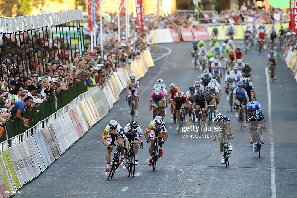 Andre Greipel (front L) of Germany outsprints Matthew Goss (2nd L) from the cycling team GreenEdge during the 51km People's Choice Classic prior to the Tour Down Under in Adelaide on January 20, 2013. The six-stage Tour Down Under takes place from January 20 to 27. AFP PHOTO / Mark Gunter USE