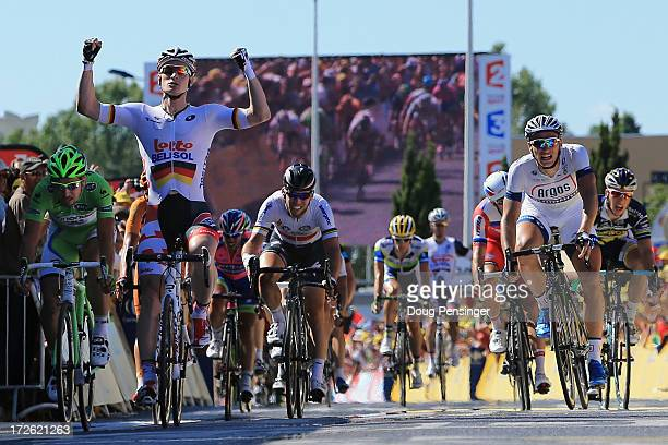Andre Greipel of Germany riding for LottoBelisol celebrates as he crosses the finish line to win stage six of the 2013 Tour de France a 1765KM road...