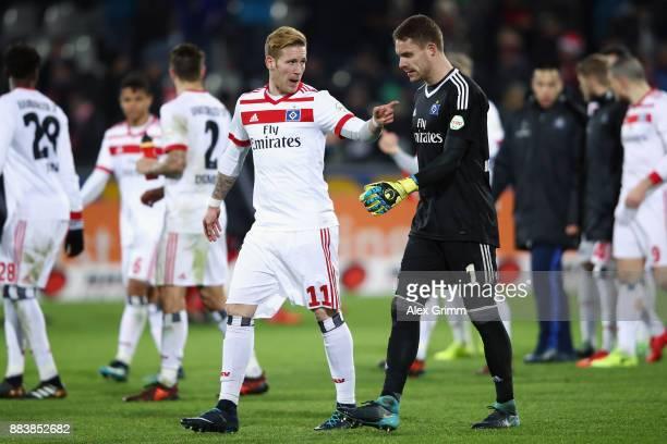 Andre Hahn and goalkeeper Christian Mathenia of Hamburg discuss after the Bundesliga match between SportClub Freiburg and Hamburger SV at...