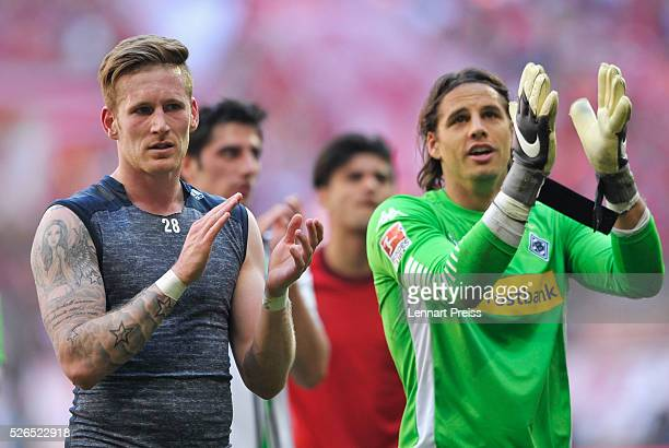 Andre Hahn and Yann Sommer of Borussia Moenchengladbach applaud away supporters after their team's 11 draw in the Bundesliga match between Bayern...