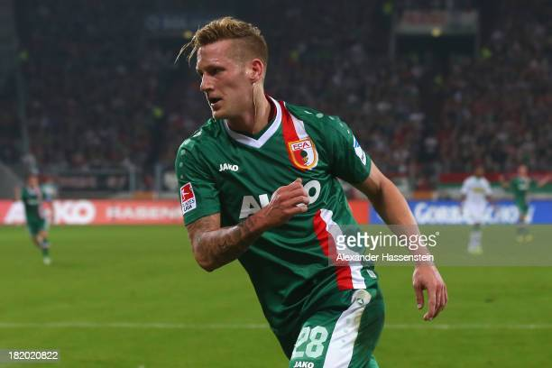 Andre Hahn of Augsburg celebrates scoring the opening goal during the Bundesliga match between FC Augsburg and Borussia Moenchengladbach at SGL Arena...