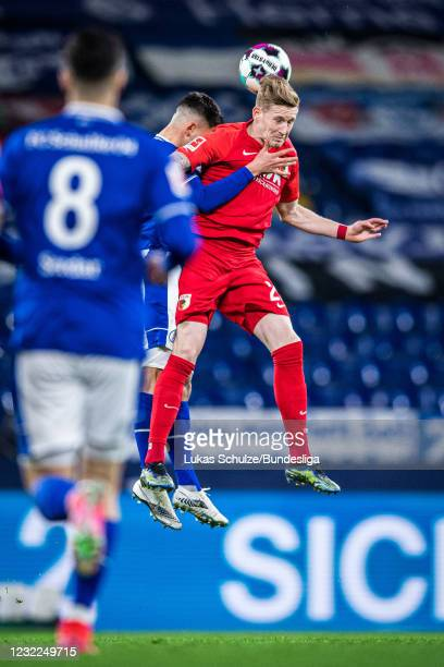Andre Hahn of Augsburg in action during the Bundesliga match between FC Schalke 04 and FC Augsburg at Veltins-Arena on April 11, 2021 in...