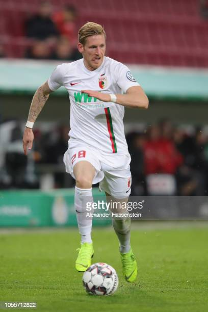 Andre Hahn of Augsburg runs with the ball during the DFB Cup match between FC Augsburg and 1 FSV Mainz 05 at WWKArena on October 30 2018 in Augsburg...