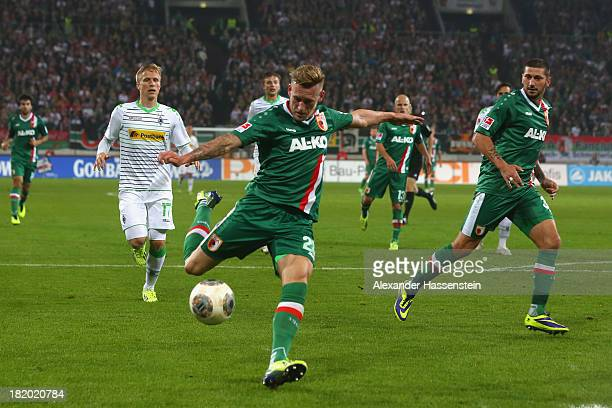 Andre Hahn of Augsburg scores the opening goal during the Bundesliga match between FC Augsburg and Borussia Moenchengladbach at SGL Arena on...
