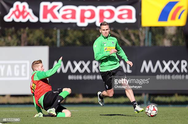 Andre Hahn of Borussia Moenchengladbach and Filip Daems of Borussia Moenchengladbach battle for the ball during a training session on day two of...