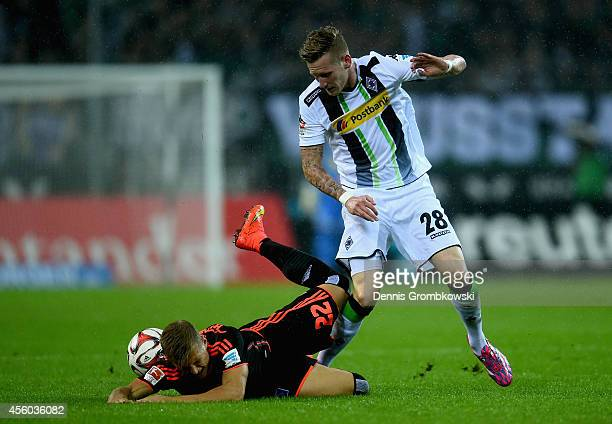 Andre Hahn of Borussia Moenchengladbach and Matthias Ostrzolek of Hamburger SV battle for the ball during the Bundesliga match between Borussia...