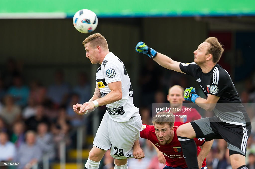 Andre Hahn of Borussia Moenchengladbach and Patrick Siefkes of SV Drochtersen/Assel battle for the ball during the DFB Cup match between SV Drochtersen/Assel and Borussia Moenchengladbach at Kehdinger Stadion on August 20, 2016 in Drochtersen, Germany.