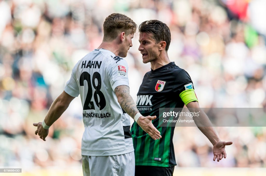 Andre Hahn of Borussia Moenchengladbach and Paul Verhaegh of FC Augsburg look angry during the Bundesliga Match between Borussia Moenchengladbach and FC Augsburg at Borussia-Park on May 06, 2017 in Moenchengladbach, Germany.