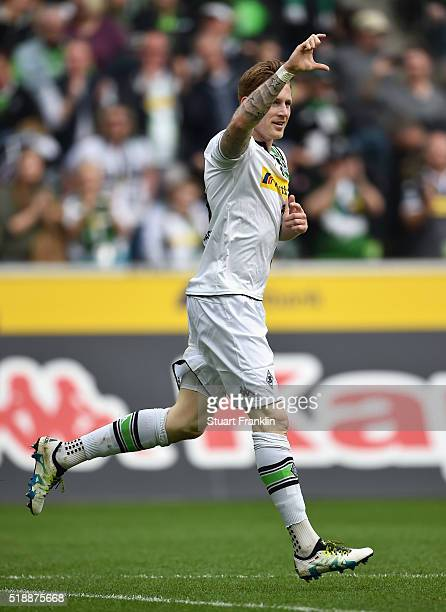 Andre Hahn of Borussia Moenchengladbach celebrates as he scores their second goal during the Bundesliga match between Borussia Moenchengladbach and...