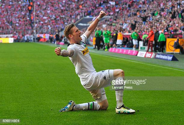 Andre Hahn of Borussia Moenchengladbach celebrates scoring his team's first goal during the Bundesliga match between Bayern Muenchen and Borussia...