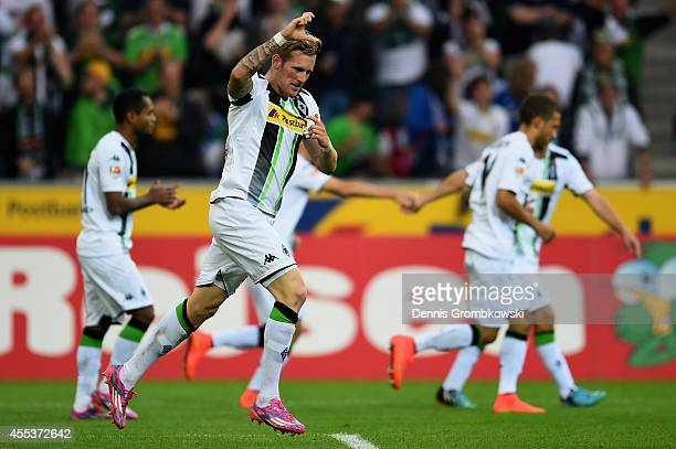 Andre Hahn of Borussia Moenchengladbach celebrates the second goal during the Bundesliga match between Borussia Moenchengladbach and FC Schalke 04 at...