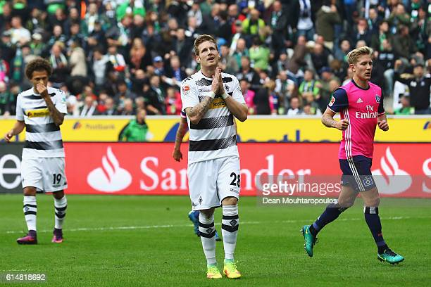 Andre Hahn of Borussia Moenchengladbach reacts after he takes and misses a penalty during the Bundesliga match between Borussia Moenchengladbach and...