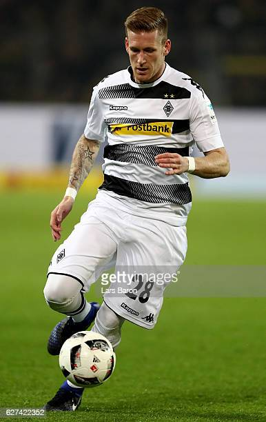 Andre Hahn of Borussia Moenchengladbach runs with the ball during the Bundesliga match between Borussia Dortmund and Borussia Moenchengladbach at...