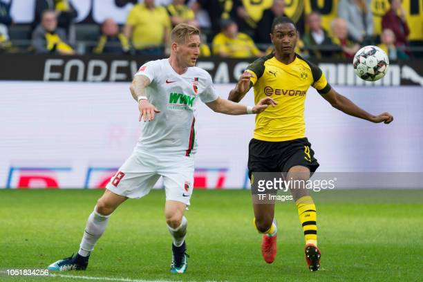 Andre Hahn of FC Augsburg and Abdou Diallo of Borussia Dortmund battle for the ball during the Bundesliga match between Borussia Dortmund and FC...