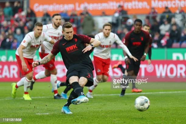 Andre Hahn of FC Augsburg misses from the penalty spot during the Bundesliga match between 1. FC Koeln and FC Augsburg at RheinEnergieStadion on...