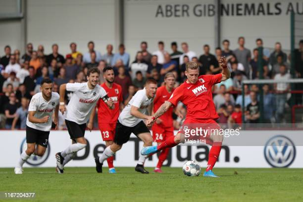 Andre Hahn of FC Augsburg scores a penalty for his team's first goal during the DFB Cup first round match between SC Verl and FC Augsburg at...