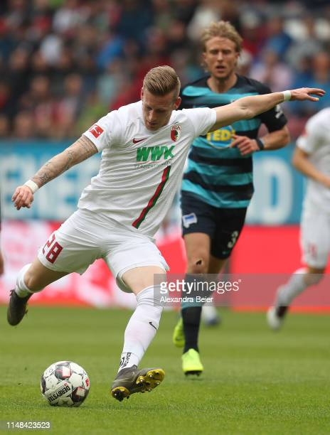 Andre Hahn of FC Augsburg scores his first goal against during the Bundesliga match between FC Augsburg and Hertha BSC at WWKArena on May 11 2019 in...