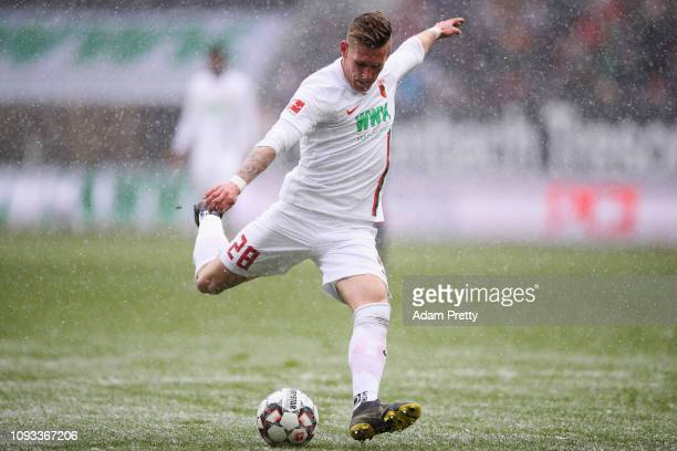 Andre Hahn of FC Augsburg shoots on goal during the Bundesliga match between FC Augsburg and 1 FSV Mainz 05 at WWKArena on February 3 2019 in...