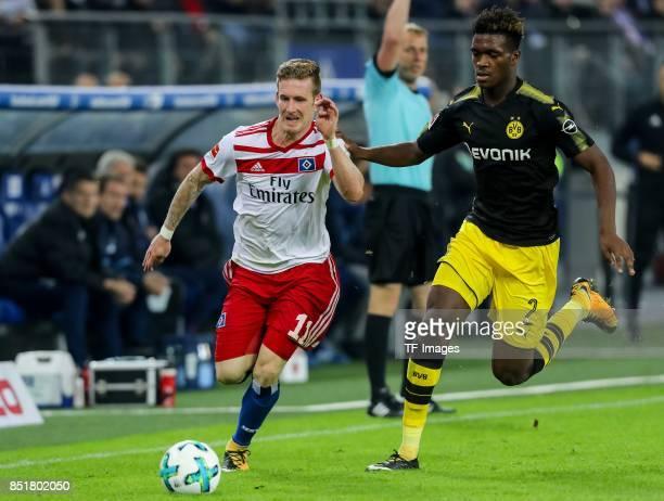 Andre Hahn of Hamburg and DanAxel Zagadou of Dortmund battle for the ball during the Bundesliga match between Hamburger SV and Borussia Dortmund at...