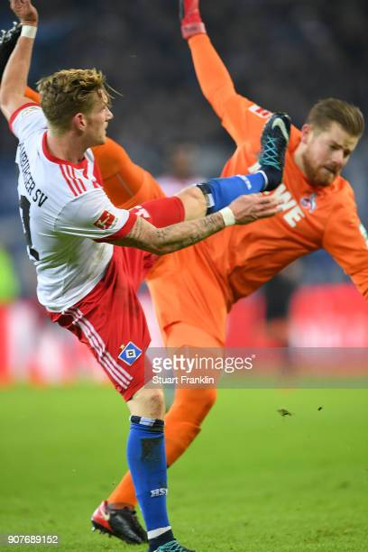 Andre Hahn of Hamburg and Timo Horn of Koeln fight for the ball during the Bundesliga match between Hamburger SV and 1 FC Koeln at Volksparkstadion...