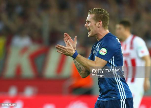 Andre Hahn of Hamburg celebrates after scoring his team`s first goal during the Bundesliga match between 1 FC Koeln and Hamburger SV at...