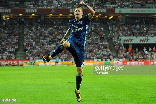 Andre Hahn of Hamburg celebrates after scoring his team`s first goal'n during the Bundesliga match between 1 FC Koeln and Hamburger SV at...