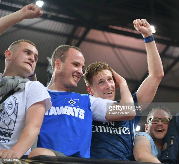 Andre Hahn of Hamburg celebrates with supporters in the stand after the Bundesliga match between 1 FC Koeln and Hamburger SV at RheinEnergieStadion...