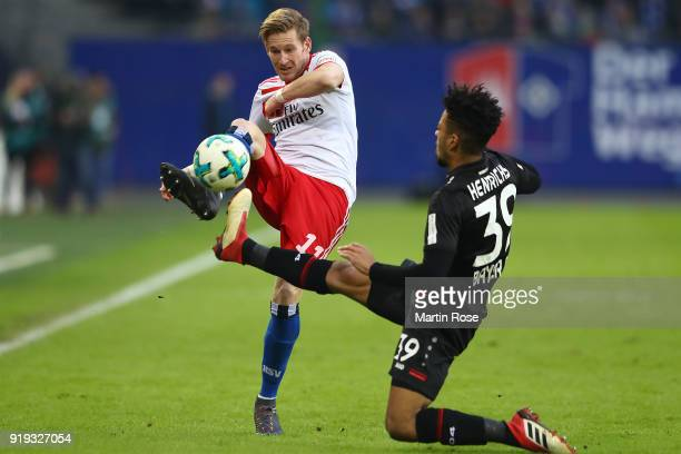 Andre Hahn of Hamburg fights for the ball with Benjamin Henrichs of Bayer Leverkusen during the Bundesliga match between Hamburger SV and Bayer 04...