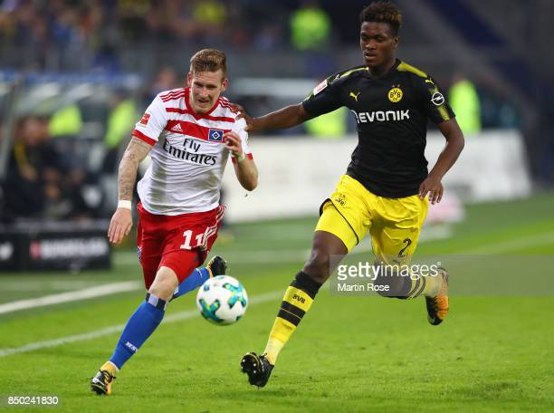 Andre Hahn of Hamburg fights for the ball with DanAxel Zagadou of Dortmund during the Bundesliga match between Hamburger SV and Borussia Dortmund at...