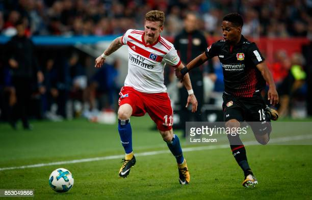 Andre Hahn of Hamburg is challenged by Wendell of Bayer Leverkusen during the Bundesliga match between Bayer 04 Leverkusen and Hamburger SV at...