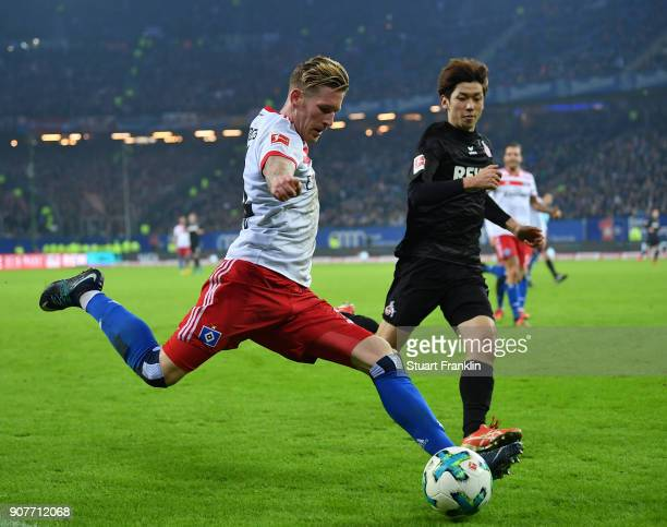 Andre Hahn of Hamburg is challenged by Yuya Osako of Cologne during the Bundesliga match between Hamburger SV and 1 FC Koeln at Volksparkstadion on...