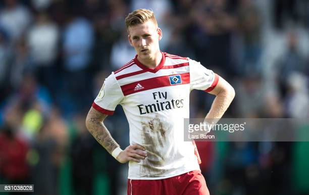 Andre Hahn of Hamburg looks dejected after loosing the DFB Cup match between VfL Osnabrueck and Hamburger SV at Osnatel Arena on August 13 2017 in...