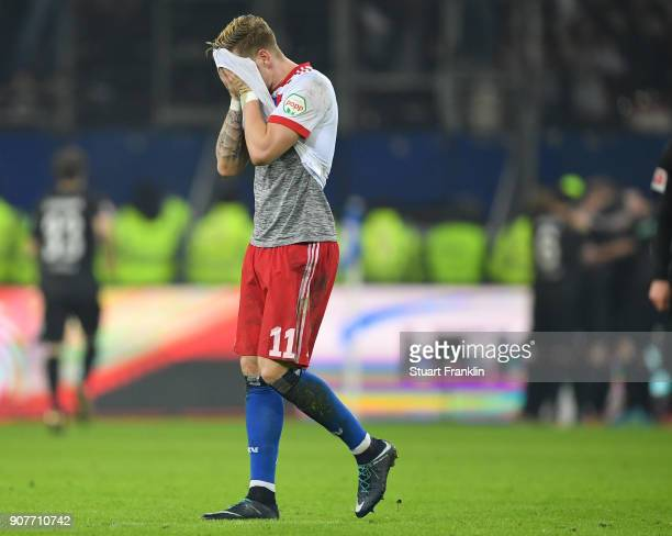 Andre Hahn of Hamburg looks dejected after the second goal during the Bundesliga match between Hamburger SV and 1 FC Koeln at Volksparkstadion on...