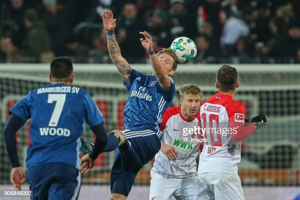 Andre Hahn of Hamburg Martin Hinteregger of Augsburg and Daniel Baier of Augsburg battle for the ball during the Bundesliga match between FC Augsburg...