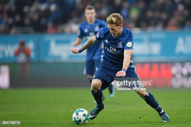 Andre Hahn of Hamburg plays the ball during the Bundesliga match between FC Augsburg and Hamburger SV at WWKArena on January 13 2018 in Augsburg...