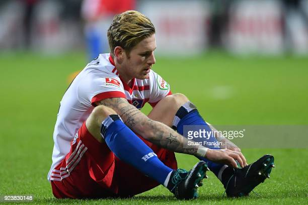 Andre Hahn of Hamburg sits on the pitch dejected after the Bundesliga match between SV Werder Bremen and Hamburger SV at Weserstadion on February 24...