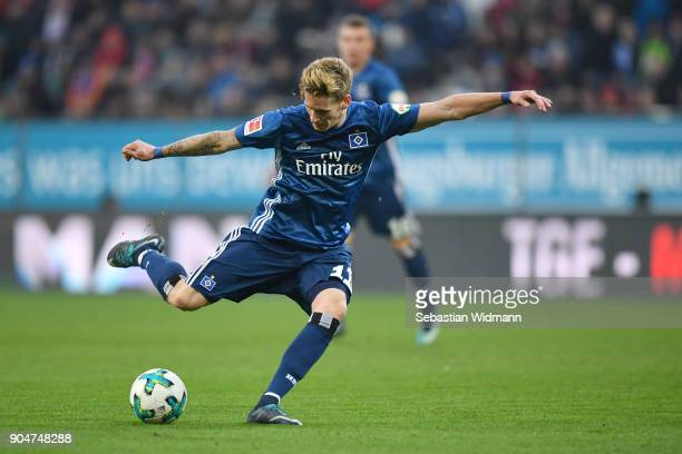 Andre Hahn of Hamburg takes a shot at the goal during the Bundesliga match between FC Augsburg and Hamburger SV at WWKArena on January 13 2018 in...