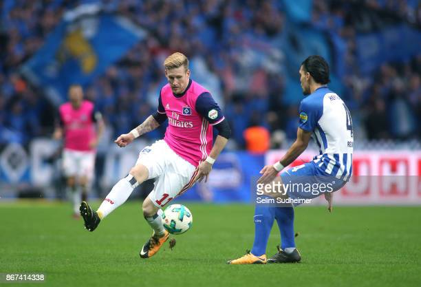 Andre Hahn of Hamburger SV fights for the ball with Karim Rekik of Hertha BSC during the Bundesliga match between Hertha BSC and Hamburger SV at...