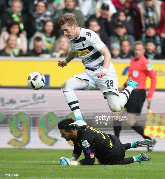 Andre Hahn of Moenchengladbach and Goalkeeper Roman Buerki of Dortmund battle for the ball during the Bundesliga match between Borussia...