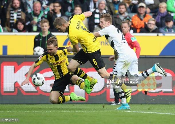 Andre Hahn of Moenchengladbach and Sven Bender of Dortmund and Marcel Schmelzer battle for the ball during the Bundesliga match between Borussia...